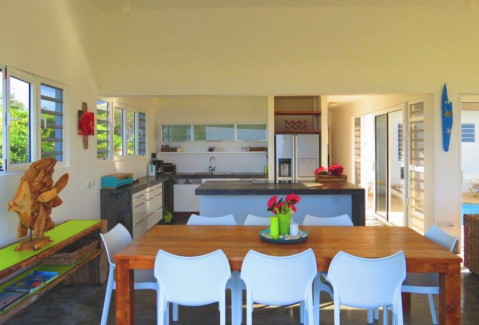 Fully equipped modern kitchen and indoor dining area